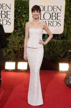 Anne Hathaway, The Les Miserables star looks all smiley and sweet in silver Chanel gown