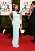 Rosario Dawson, all mighty and proud in peplum gown.